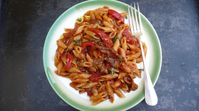 a delicious plate of pasta with porcini and sweet peppers in tomato sauce