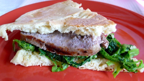 torta al testo stuffed with grilled sausage and rapini (cime di rapa)
