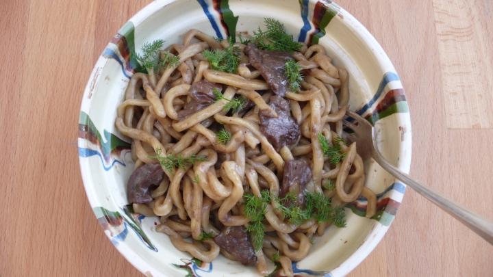 fresh Umbrian stringozzi pasta in a red wine porcini sauce
