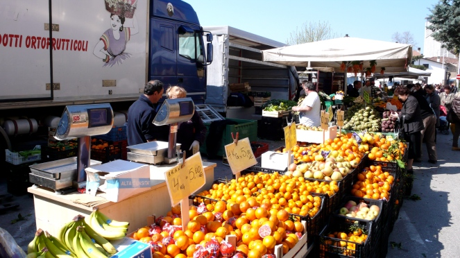 oranges and artichokes stand at Italian market