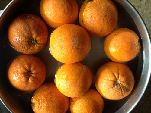 Soak oranges in a large pot or bowl
