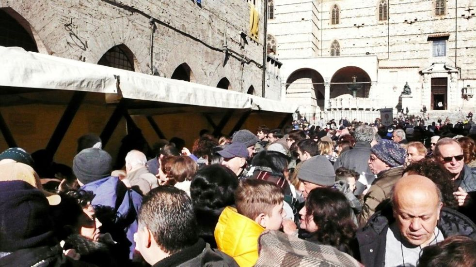 The citizens of Perugia enjoying the San Costanzo fair and a free tasting of the torcolo cake