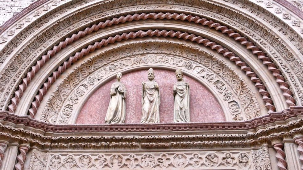 San Lorenzo, Sant'Ercolano and San Costanzo sculpted in the XIV century grand entrance portal of Perugia's city hall.