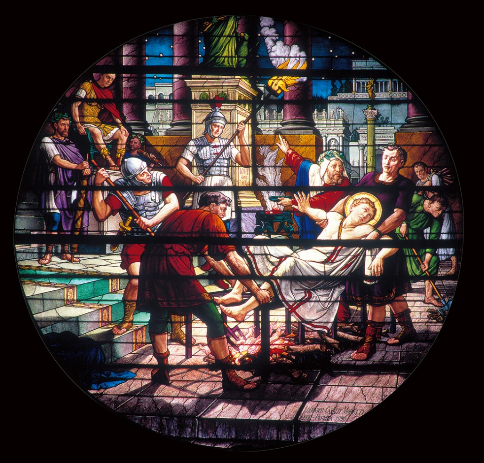 A splendid stained glass round window of Perugia's Cathedral , made at the historic Glass studio Moretti Caselli, representing the marytrdom of Laurence of Rome.