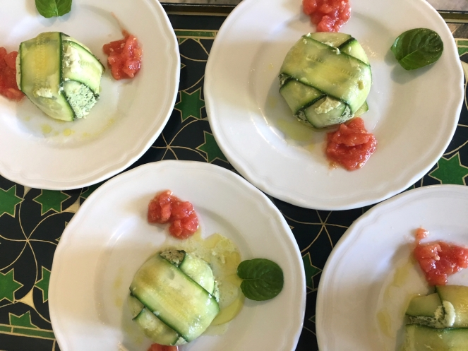 Italian style zucchini flans made with ricotta, mint and eggs and served with a small tomato salad