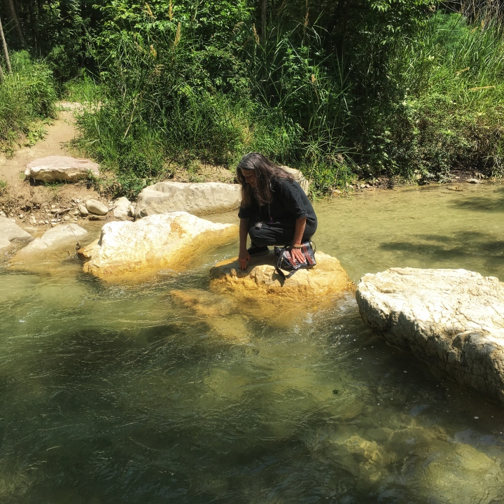 Artist Diana Baur in the middle of a beautiful river in Umbria