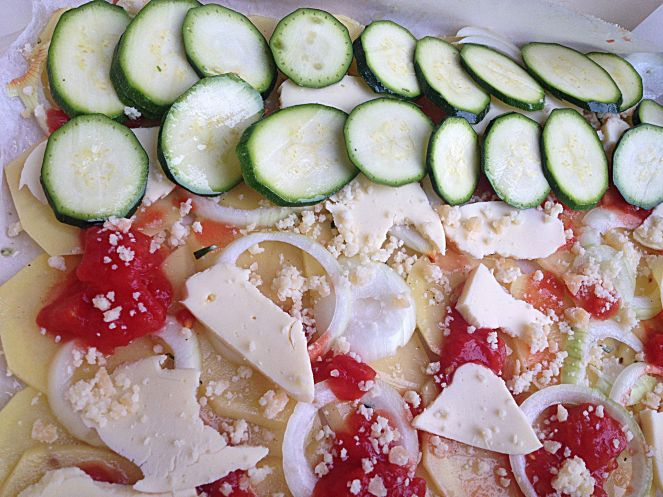 layered baked vegetables with cheese and tomato