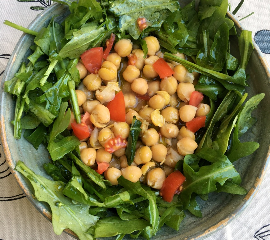 chickpea soup with rucola arugula rocket and tomato